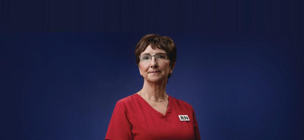 Registered Nurse in red scrubs