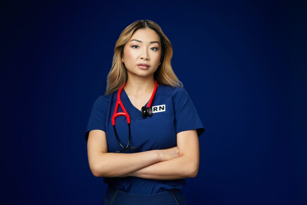 nurse with red stethoscope and arms crossed