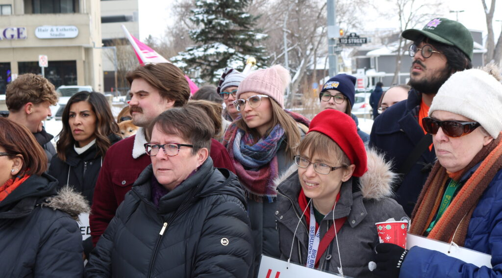 crowd of nurses in winter clothes at a rally